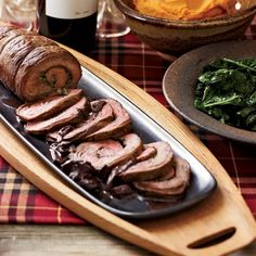 Flank Steak Spirals with Porcini & Red Wine Sauce --- from Food & Wine --- Mario Monticelli, the winemaker for Trinchero Napa Valley, learned to make this stuffed steak from his mother. More Amazing Steaks . Beef Flank Steak, Flank Steak Recipes, Beef Steaks, Sauce Recipes, Meat Recipes, Wine Recipes, Lamb Recipes, Recipies, Cooking With Red Wine