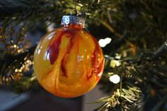 Clear Ornaments With Paint Inside in wedding colors then write names & dates on outside with marker