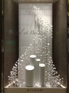 3d hears suspended in a wave patter for jewelry Window Display and Visual Merchandising