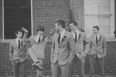 This one just makes me laugh--it's the goofiness again (which won't be a problem with the groomsmen!!)!  I also like the brick wall background and the triangle that the guys are in.  I like seeing that depth in the picture.