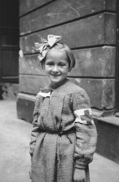 Portrait of a girl with a bandage nurse during the Warsaw uprising. Warsaw, Poland, 1944.
