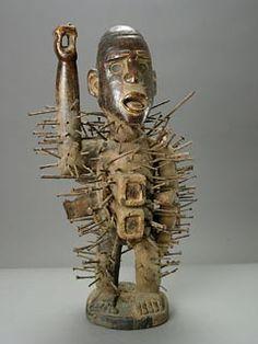 "Kongo Wooden Nkisi Nkondi Sculpture - PF.5125 Origin: Southwestern Congo/Angola Circa: 20 th Century AD Dimensions: 22.75"" (57.8cm) high Collection: African Medium: Wood, Iron, Glass to view original image."