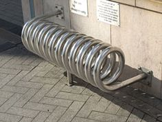 an unusual stainless steel bike rack