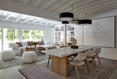 A view into the living and dining room, where newly-exposed beams add an architectural element.