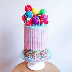 I think I've found my spirit cake! This whopper consists of six rainbow vanilla sponge cake layers, covered in rose water buttercream, white chocolate ganache & is adorned with fruity bubblegum pops! Pretty Cakes, Cute Cakes, Beautiful Cakes, Yummy Cakes, Amazing Cakes, Crazy Cakes, Lollipop Cake, Cupcake Cakes, Cake Land