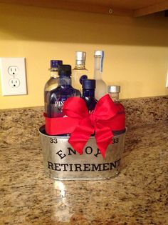 Vodka Retirement Basket,,,,super easy! Floral styrofoam as the base and hot glued bottles to base....hot glued a wire ribbon and used sticker letters.