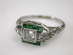 Edwardian Engagement Ring with Channel Set Synthetic Emeralds. I love the fine filigree detail.