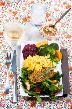 An absolutely amazing vegan, gluten-free Thanksgiving meal, courtesy of Allyson Kramer: Quinoa No-Turkey Loaf, Acorn Squash Mac N Cheese, Cardamom Orange Broccoli, Spiked Cranberry Sauce, Garlicky Green Salad, and Pumpkin Spice Custard.
