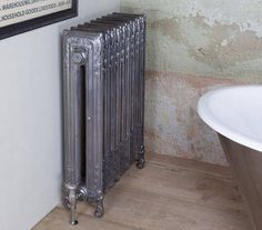 The Scroll cast iron radiator is a tall slim, square ended radiator with 2 columns; it boasts a delightful series of swirls and floral patterns, separated by crisp dividing lines. It is finished with uniquely inward scroll feet that complete its stylish look. The scroll radiator comes in a height of 845mm tall and the depth is 204mm. It has a heat output of 501 BTU's per section based on Delta 60. The radiators can be painted in a colour of your choice or in any of our standard colours.