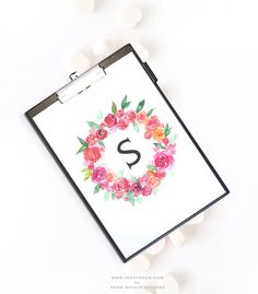 Learn how to create a watercolor floral wreath monogram in this tutorial by Zakkiya Hamza of Inkstruck Studio for Dawn Nicole designs