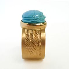 Turquoise scarab set in 18 kt. gold. $1790