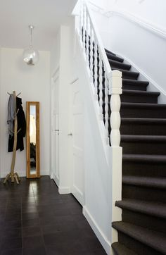 chic and easy entry maintenance | charcoal slate and outdoor carpet with glossy white enamel