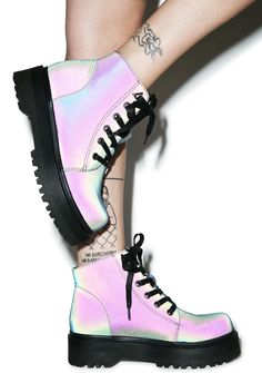 Y.R.U. Slayr Boots yer gonna make Buffy jealous in these bad bbs! Show 'em how ya slayyy in these gnarly platform lace up combat boots, featuring a thick treaded platform, silver hardware, a rounded toe, and hypnotizing hologram coated material that shifts from an oil slick dark grey to iridescent huez of purples 'n greens under yer camera's flashin' lights.