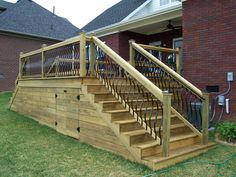 Deckorators spindles wood deck with horizontal skirting deck boards the handrails were placed in from the edge of the steps so flower pots could sit on the edge of steps