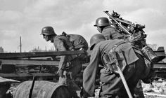 German patrol  in Stalingrad City. Notice the soldier on the right that seems to be carryng a tripod for a MG in defensive role . Russia WW II