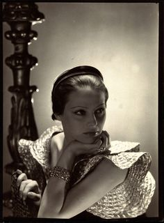 Mme. Hilling, wears Lanvin's Russian diadem of ebony and silver metal, and quilted silver sleeves to great effect. - Photo: George Hoyningen-Huene, Vogue, October 1, 1933