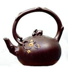 Yixing teapots are collectible teapots made in Yixing, China. They are created from a special clay that is found only in the area around Lake Taihu in China. The clay, because it is made up of iron, quartz, and mica, is naturally a purple color. The clay, called zisha, retains heat extremely well, absorbs the flavors of the tea brewed in it, and, over a period of time, the pot is literally infused with the tea flavor.