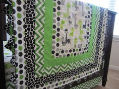 Green, Gray and Black Giraffe Baby Quilt, Crib Skirt, Fitted Crib Sheet and Reversible Rail Guard by QuiltingThyme on Etsy https://www.etsy.com/listing/183476371/green-gray-and-black-giraffe-baby-quilt   For any of these that I've pinned we can swap out a fabric for one we prefer ...