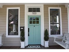 Aqua front door with taupe siding