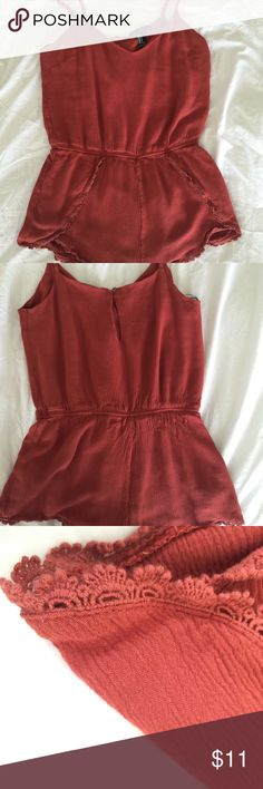 F21 Romper Only been worn once! Adjustable straps and keyhole detail in back. Lace trim around shorts Forever 21 Other