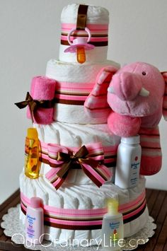 Diaper Cake Includes:  70-75 size 1 diapers! Hello, great gift in itself for new moms!  Pink cotton washcloths.  Diaper rash cream.  Baby wash  Baby shampoo  Toy elephant  Pacifier  Baby Powder  Baby lotion