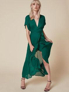 For summer weddings or also just summer. This is an ankle length wrap dress with a low v neck and high slit.