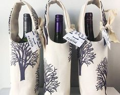 Hand printed bottle totes. One of a kind, sturdy, pretty tote for your next dinner party host! Sustainable Textiles, Sustainable Gifts, Cheap Wine Glasses, Wine Down Wednesday, Wine Tote Bag, Cosmetics And Toiletries, Wine Carrier, Different Wines, Craft Bags