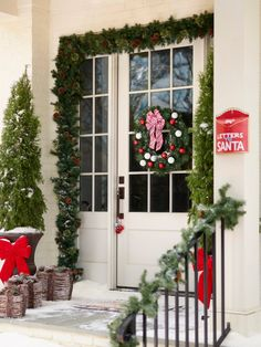 Need some outdoor Christmas decoration ideas? Lowe's has you covered. We'll help you deck out your front yard for the season. #garland #wreath #santa #holiday