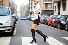 Two-toned jacket and black tall boots // MFW street style