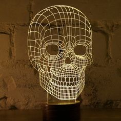 Studio Cheha in Tel Aviv, Israel is behind this innovative LED lamp that tricks your mind into thinking it's looking at a object. BULBING is a lamp created using wire-frame Luminaire Design, Lamp Design, Light Design, Crane, Skull 3d, Human Skull, Night Light, Light Up, Lamp Light