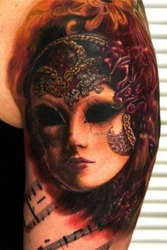 Татуировка театральная маска на предплечье для мужчин