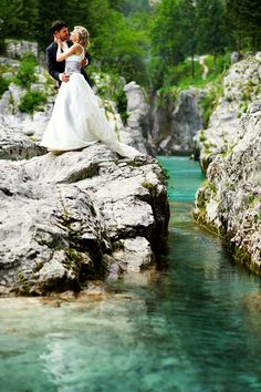 Bride and groom at gorgeous turquoise river Soca, wedding at Pristava Lepena, Slovenia www.samorovan.com