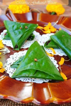 Meetha Gulkand Paan (Sweet rose-petal jam betel leaf) - what it looks like rolled up, its also rolled up in a tubular shape