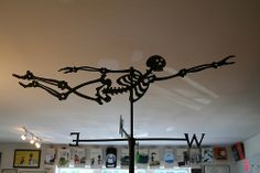 Midnight in the Garden of Evil: Skeleton Weather Vane - You can buy your own for $725 (which includes shipping.) [: