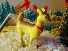~~Celluloid Deer Ornament ~~  Circa 1950s  Adorable celluloid deer/figurine ornament....she has a red bow scarf around her neck and a place on