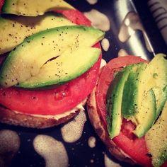 Hummus, tomato and avocado on an english muffin..