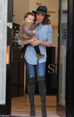 Sharp: Wearing double denim with over-the-knee boots and a charcoal grey trilby, the yummy...