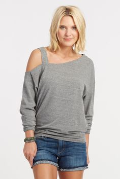 ffbdeddf30042 This cold shoulder sweater brings a little sexiness to a ...