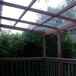 Clear Polycarbonate for the deck roof. No rain and still lets the sunshine in. This might be the way to go