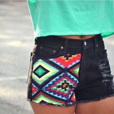 Aztec Print stitched on a distressed pair of denim shorts paired with a cool tee, and u're good to go ...la la the summer sun.