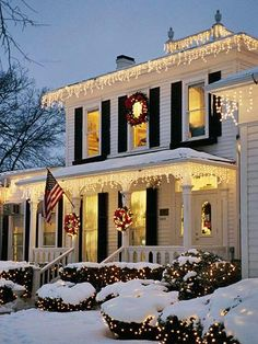 Home with icicle outdoor lights and wreaths on the door and windows. | outside Christmas decorations