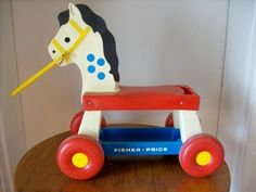 Fisher Price Ride-On Horse Around 1976 my brother had one of these Fisher Price Ride-On Horses. Fisher Price Toys, Vintage Fisher Price, Retro Toys, Vintage Toys, Fisher Price Rocking Horse, Old School Toys, Gift From Heaven, Kids Growing Up, Big Wheel