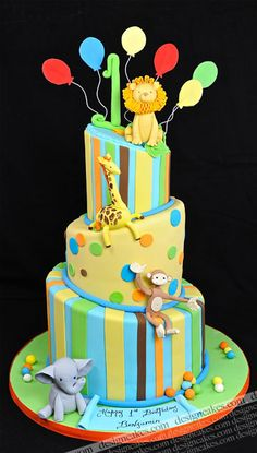 topsy turvy jungle animal birthday cake by Design Cakes, via Flickr