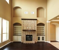 Kinsmen Homes Katherine plan in CastlegateII, College Station.  Two story cathedral ceiling in Family Room with brick fireplace, art niches and built in cabinetry.
