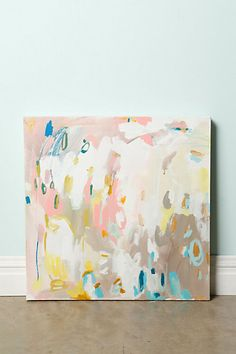 """Ashley By Michelle Armas  DETAILS  Aiming to evoke a light and playful mood, Atlanta-based artist Michelle Armas' acrylic on canvas certainly uplifts with a delightful mix of pastel strokes and deep turquoise markings.  One of a kind  Unframed  Acrylic on canvas  24"""" square  Handmade in USA"""