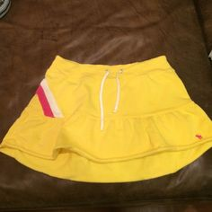 Abercrombie kids yellow skirt In great condition! Yellow, pink and white. Abercrombie & Fitch Bottoms Skirts