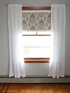 Ways to Add Polish to Any Kind of WindowDoctor a plain white roller shade with the fabric of your choice, and a tassel to boot.