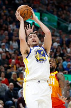 Utah Jazz forward Royce O'Neale, rear, defends against Golden State Warriors guard Klay Thompson (11) in the first half during an NBA basketball game Tuesday, Jan. 30, 2018, in Salt Lake City. (AP Photo/Rick Bowmer)