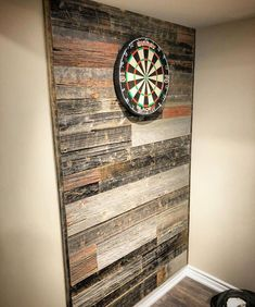 Darts anyone? Here is a cool mixed tone reclaimed barn board wall our Durham Region shop did for a client in their basement. This adds some nice rustic charm and also hides errant dart marks a bit better than drywall. Man Cave Basement, Basement Walls, Basement Ideas, Basement Flooring, Playroom Ideas, Teen Basement, Basement Layout, Rustic Basement, Basement Furniture
