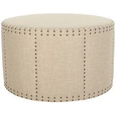 A nailhead trim gives this beige ottoman personality. | $379